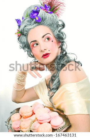 Victorian lady. Young woman in eighteenth century image posing with sweets - stock photo