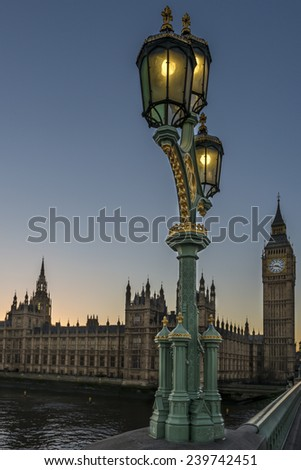 Victorian ornate street lights on Westminster Bridge with the Houses of Parliament in the background at sunset