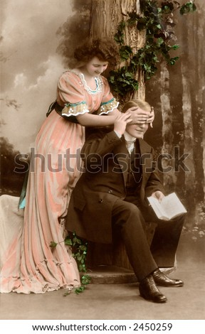 Victorian romance - couple in love - circa 1912 hand-tinted photograph - stock photo