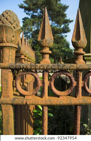 Victorian rusting cast iron railing spike in graveyard - stock photo