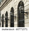 Victorian Street lamps on the building front, Sugar Quay, London, UK - stock photo