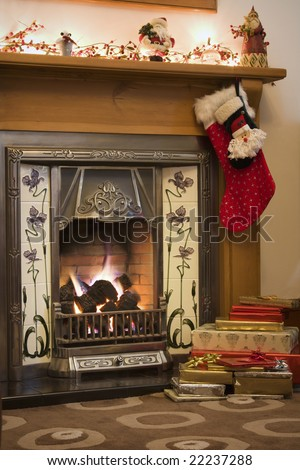Victorian style fireplace ready for Christmas - stock photo