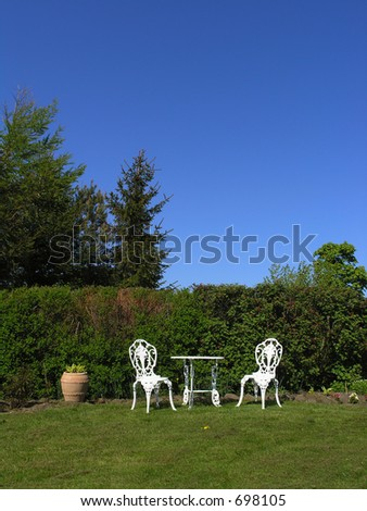Victorian style garden furniture in natural settings - stock photo