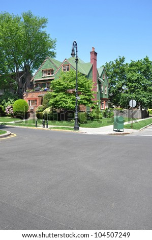 Victorian Style Home Corner Suburban Blacktop Street Sign Mailbox Fire Hydrant Lamppost Stop Sign Pedestrian Crosswalk Residential Neighborhood