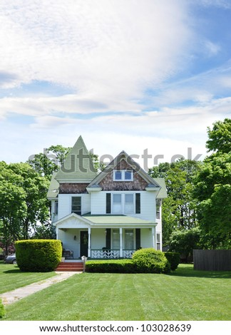 Victorian Suburban Home set back on front yard lawn Residential Neighborhood - stock photo