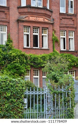 victorian urban mansion - stock photo