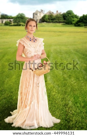 Victorian woman with basket of roses - stock photo