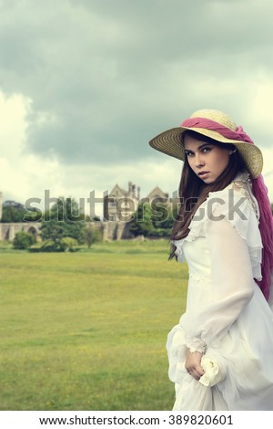 victorian woman with manor house - stock photo