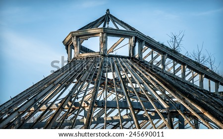 Victorian wooden framed greenhouse ruin. - stock photo