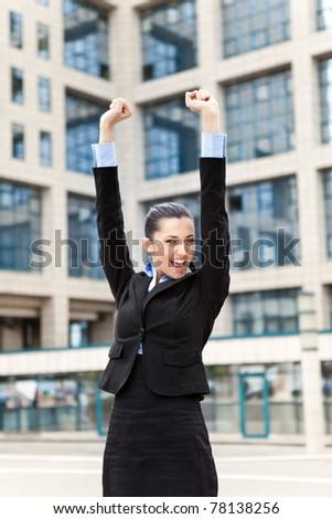 victorious businesswoman celebration her success - stock photo