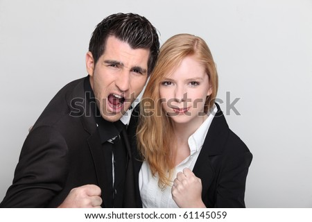 Victorious couple with raised fist