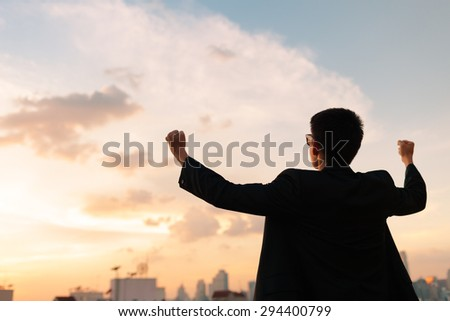 Victorious man in the city. - stock photo