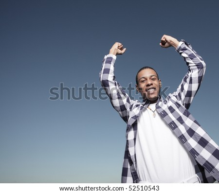 Victorious teenager - stock photo