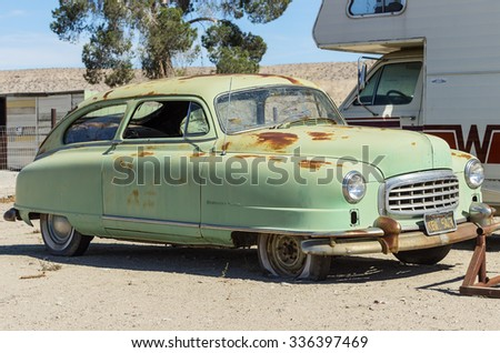 VICTORVILLE, CALIFORNIA/USA - NOVEMBER 5 2015: a 1949 Nash car (Statesman Custom) rusting in the Mojave desert. Manufactured by Nash Motors, the automotive division of the Nash-Kelvinator Corporation. - stock photo