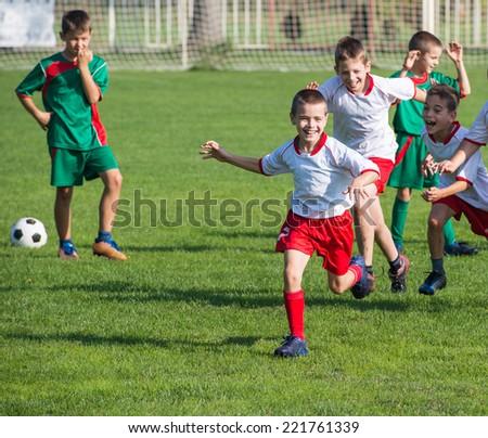 victory on Kids football match - stock photo