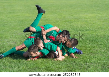 victory on Kids football match - stock photo