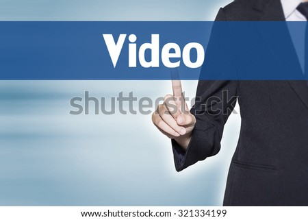 Video Business woman pointing at word for business background concept - stock photo