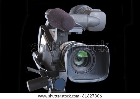 Video Camera (isolated on a black background) - stock photo