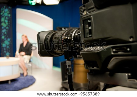 Video camera lens - recording show in TV studio - focus on camera - stock photo