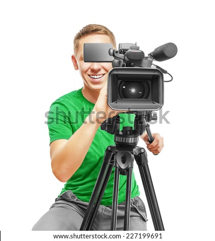 Video camera operator smile and working with his professional equipment isolated on white background - stock photo