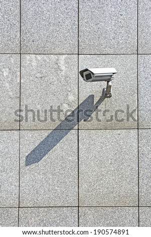 Video Camera Security System on the wall - stock photo