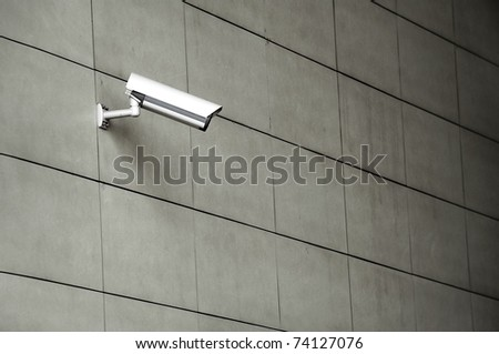 Video Camera Security System on the wall. - stock photo