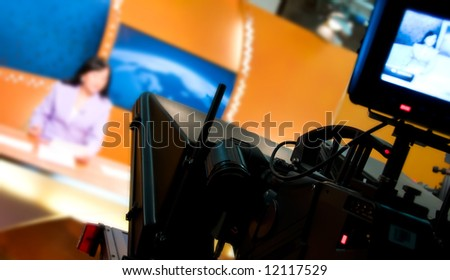 Video camera viewfinder - recording in TV news studio - Talking To The Camera - stock photo
