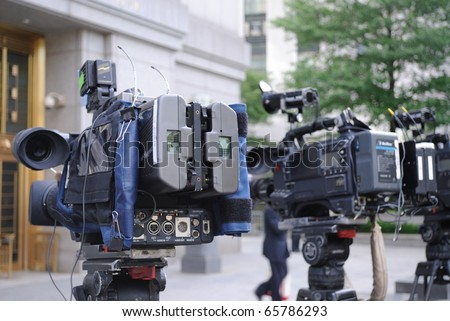 video cameras poised outside of a courthouse - stock photo
