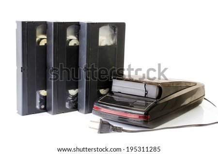 Video Cassette and Vintage VHS Rewinder isolate on white background - stock photo
