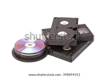 Video Cassettes And CD discs isolated on white background - stock photo