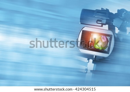 Video Documentary Background with Digital HD Camcorder and Copy Space. - stock photo