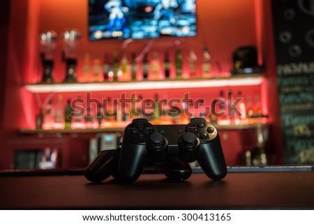 Video games at bar counter - stock photo