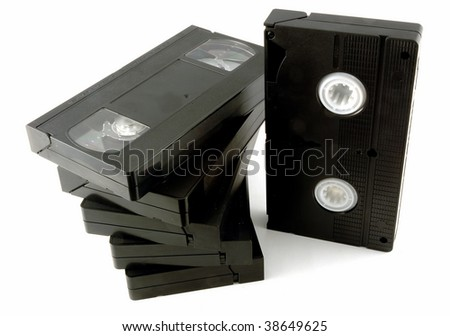 Video Home System, better known by its abbreviation VHS, is a video tape recording standard developed during the 1970s. - stock photo
