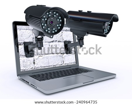 Video surveillance camera and laptop - stock photo