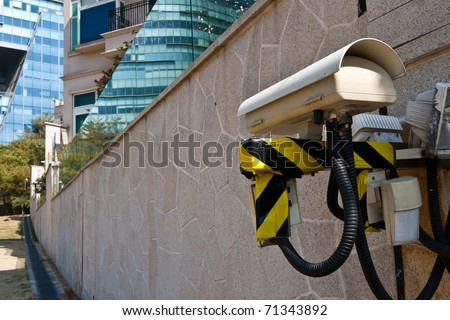 Video surveillance watching a road outside a house - stock photo