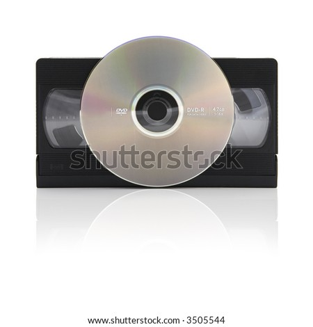 video tape versus digital video disc on a white background with mirror shadow - stock photo
