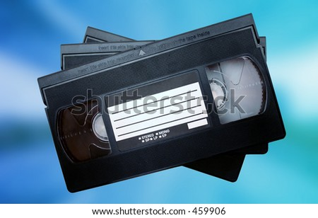 Video tapes against colorful background - stock photo