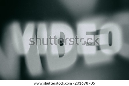Video word on vintage blurred background, concept sign