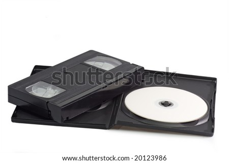 Videocassette and digital versatile disc isolated on white background - stock photo