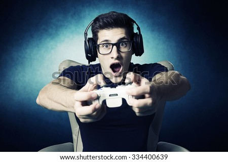 videogame addicted young guy playing with console  - stock photo