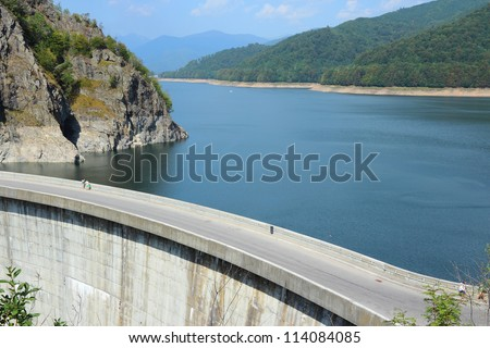 Vidraru Dam on Arges River in Transylvania, Romania. Hydroelectric power station. - stock photo