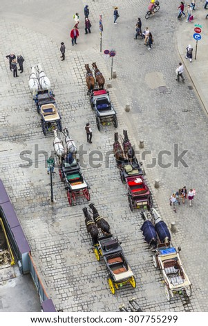 VIENNA - APR 24, 2015: aerial of crowded Stephansplatz in Vienna, Austria with fiakers. Severalpopular pedestrian routes begin here and a lot of tourists visit this place.