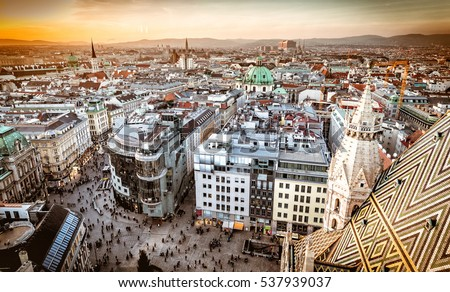 Vienna at sunset, aerial view from above the city