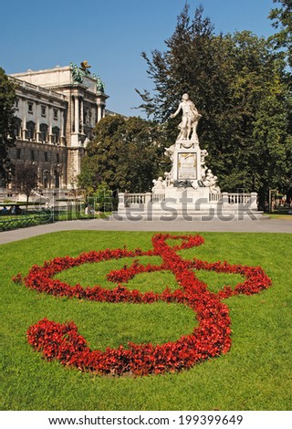 VIENNA - AUGUST 8: Statue of Amadeus Mozart with flower beds as treble clef in Burggarten in Vienna, Austria on August 8, 2011. - stock photo