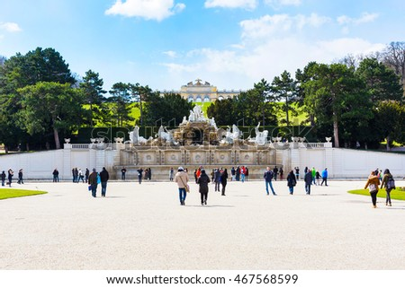 Vienna, Austia - April 3, 2015: People going towards The Neptune Fountain and Gloriette at the Schonbrunn, Vienna, Austria