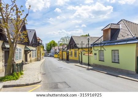 VIENNA, AUSTRIA - APR 27, 2015: narrow street in village of Grinzing in Vienna, Austria in early morning light. Grinzing is a famous vinemaker village. - stock photo