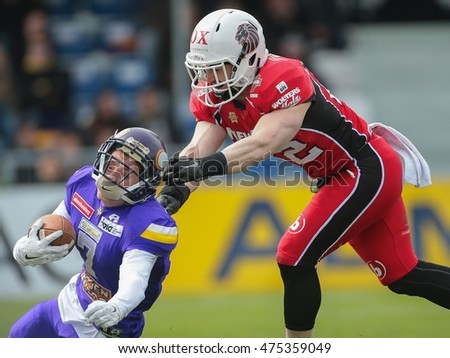 VIENNA, AUSTRIA - April 4, 2016: Christian Petersen (New Yorker Lions Braunschweig) tackles Dominik Bubik (Vienna Vikings) in a game of the Big Six Football League.
