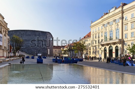 VIENNA, AUSTRIA - APRIL 17: Many people enjoy a sunny afternoon at the Museumsquartier on April 17, 2014 in Vienna, Austria. It is the eighth largest cultural area in the world. - stock photo