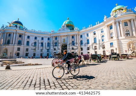 VIENNA, AUSTRIA - APRIL 21, 2016: Michaelerplatz and Hofburg Palace with fiacres and tourists  - stock photo