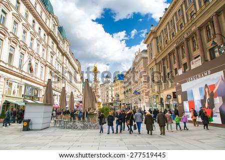 Vienna, Austria - April 3, 2015: Plague column and Graben Street view with people walking in Vienna, Austria  - stock photo